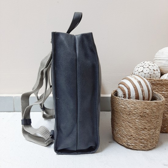 Backpack with clasp on top